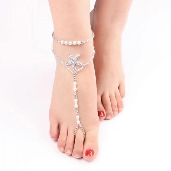 Náramek přes kotník z perleťových korálků a štrasovou hvězdicí